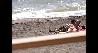 Hot babe gives blowjob to her guy on a beach